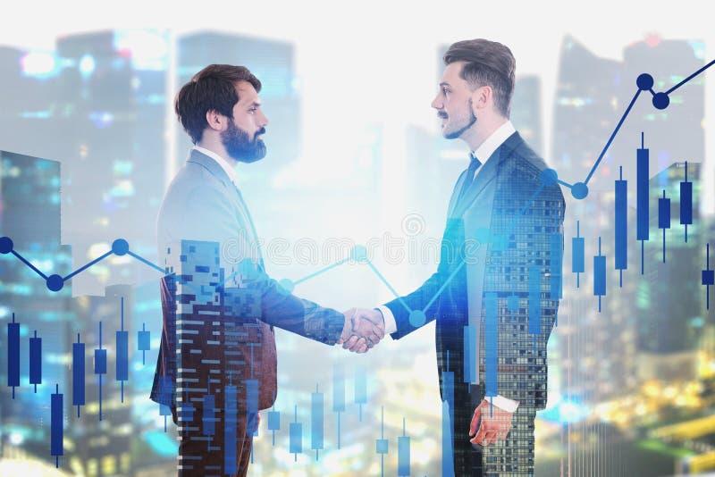 Handshake of business people, digital chart royalty free stock photo
