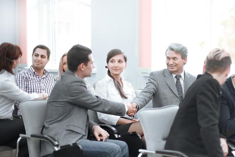 Handshake business people at a seminar in the conference room. stock photography