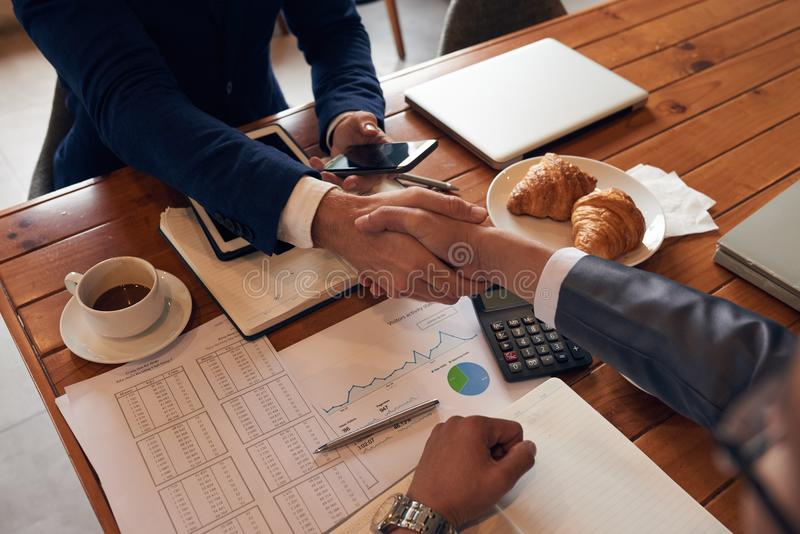 Handshake. Business people shaking hands before meeting, view from above stock photography