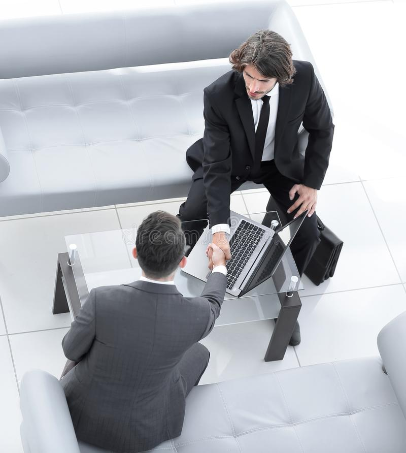 Handshake business people in the workplace. Business concept royalty free stock photo