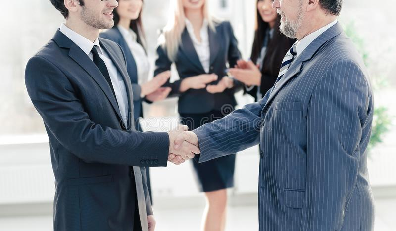 Handshake of a businessman and business woman royalty free stock photography