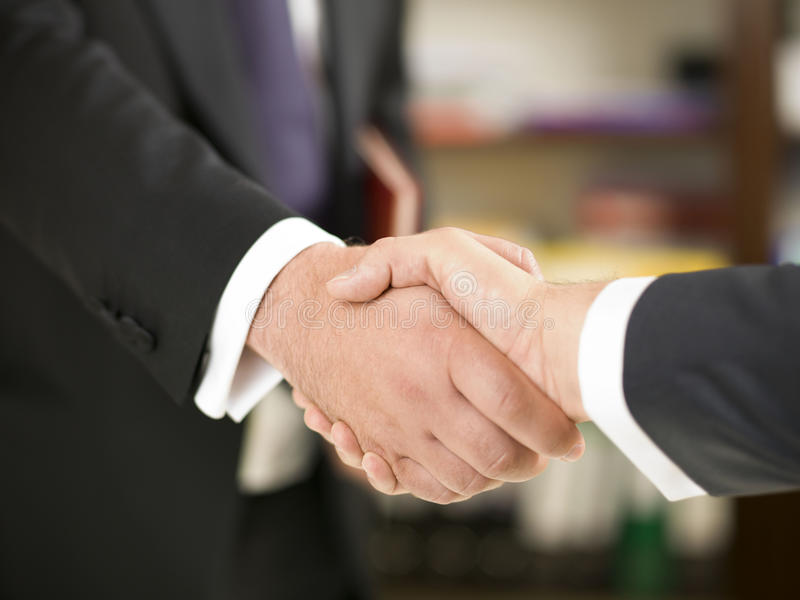Handshake. Businessman shaking hands with partner royalty free stock photography