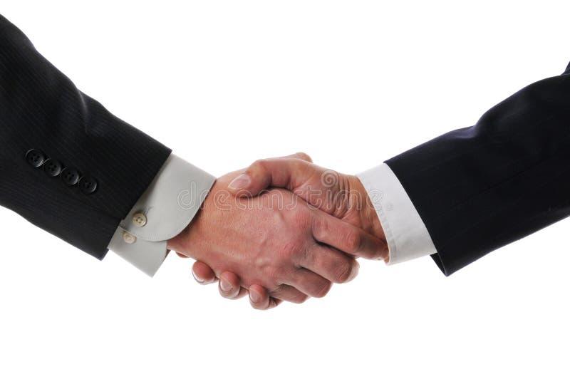 Handshake between businessmen royalty free stock photography