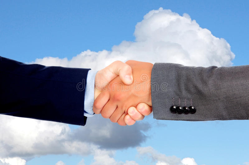 Handshake with businessmen on a blue sky royalty free stock photography