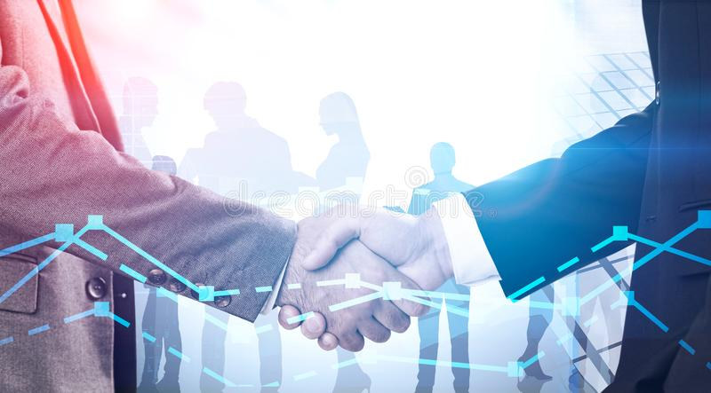 Handshake of businessmen in city, graph royalty free stock photos