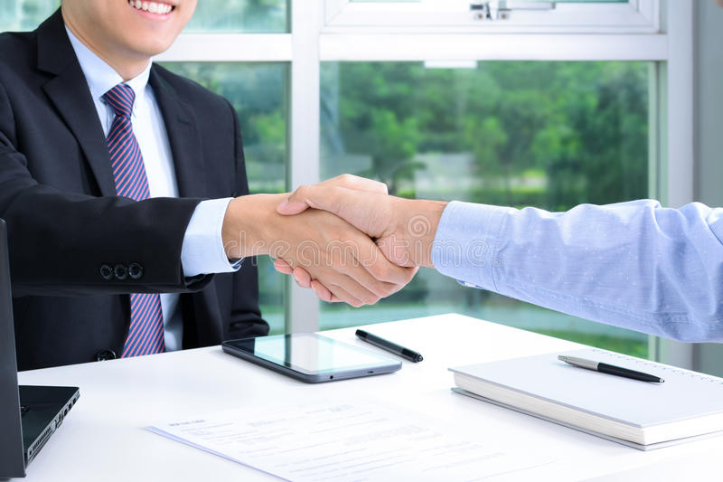 Handshake of businessmen in the office. Making an agreement and dealing concepts royalty free stock images