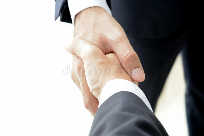Handshake of businessmen on white background. Handshake of businessmen - success, congratulation, greeting & business partner concepts stock photos