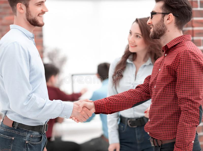 Closeup image of business partners making handshake in an office stock photos