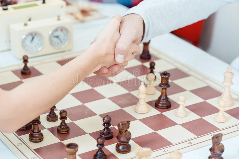Handshake after Checkmate stock photos