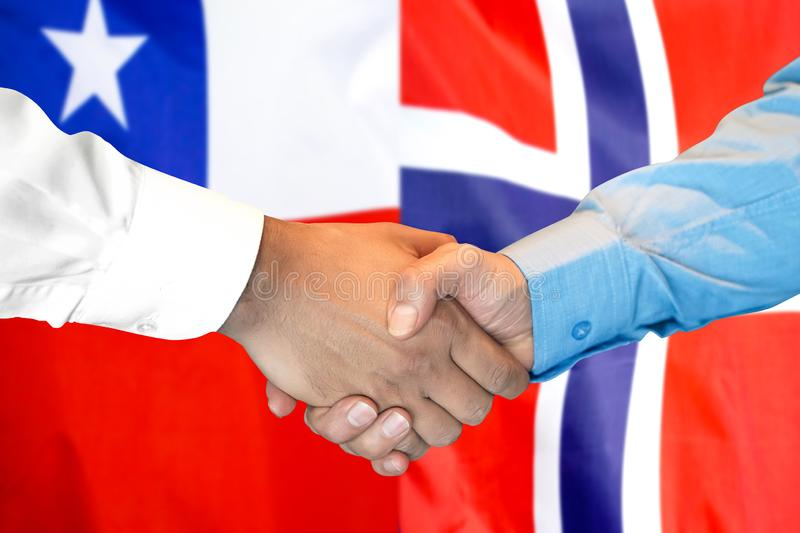 Handshake on Chile and Norway flag background royalty free stock images