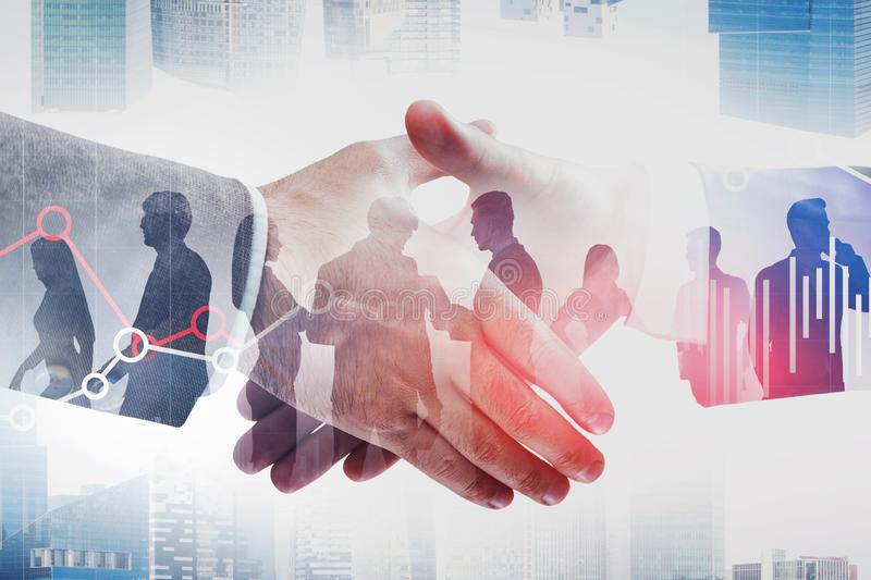 Handshake in city, business people and graph stock photo