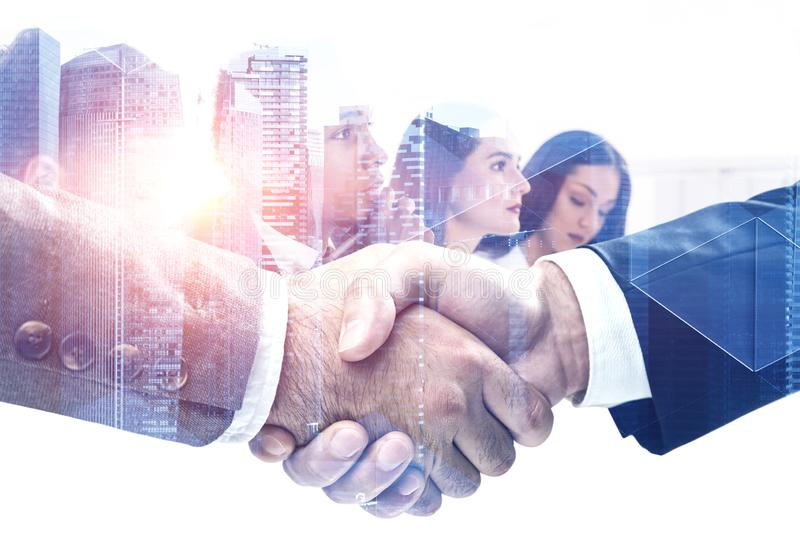 Handshake in city, business team royalty free stock image