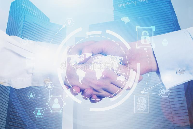 Handshake in city, global business interface royalty free stock photo