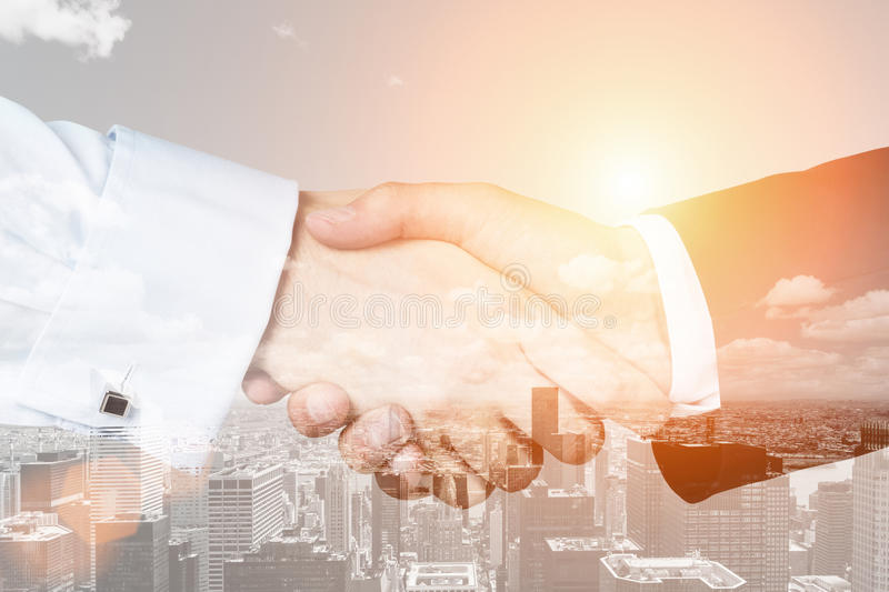 Handshake close up in a city royalty free stock photos