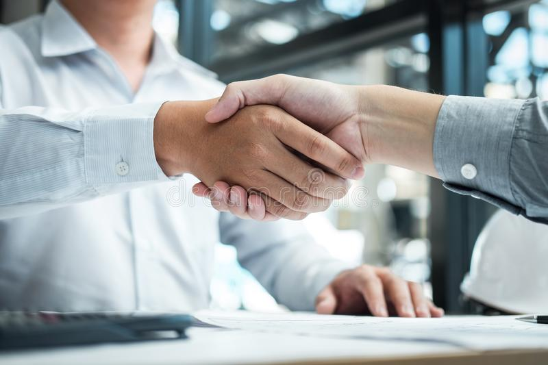 Handshake of collaboration, Construction engineering or architect discuss a blueprint and building model while checking royalty free stock photos