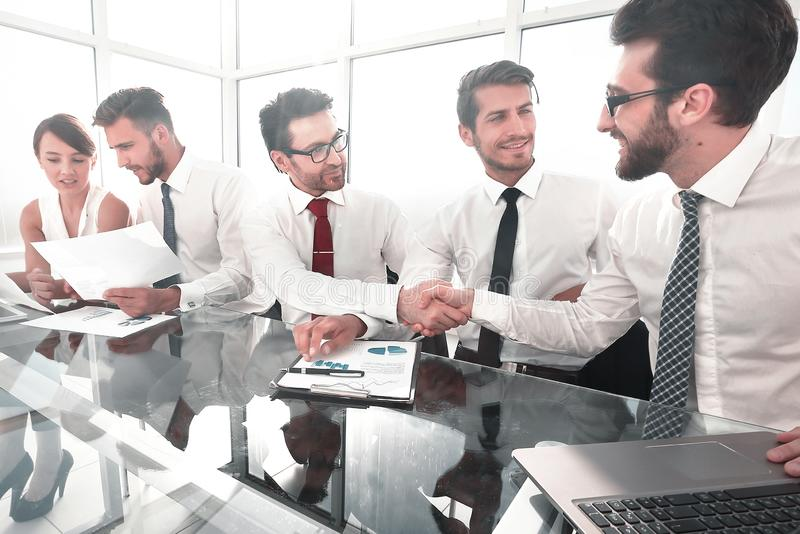 Handshake colleagues at a working meeting royalty free stock image