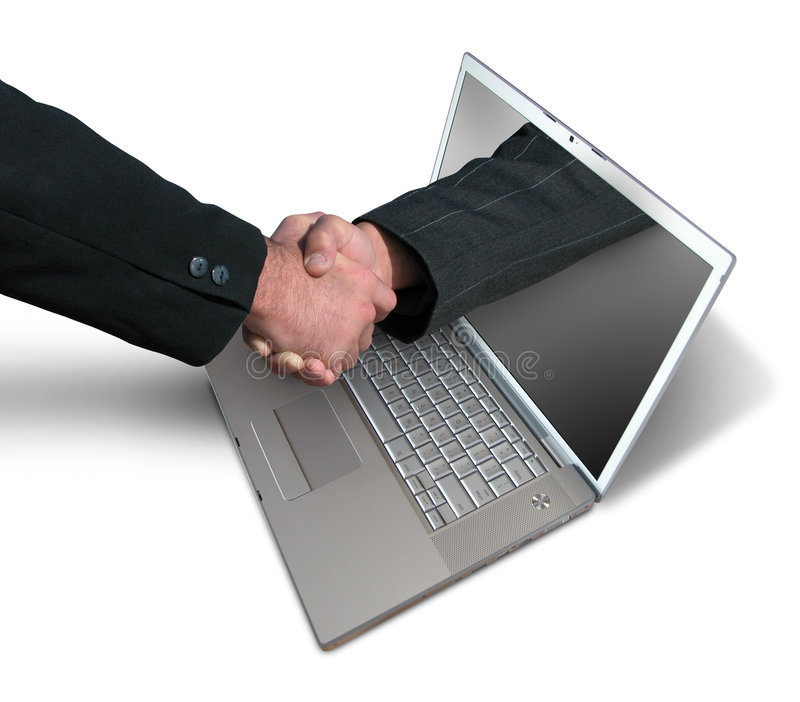Handshake through computer royalty free stock photos