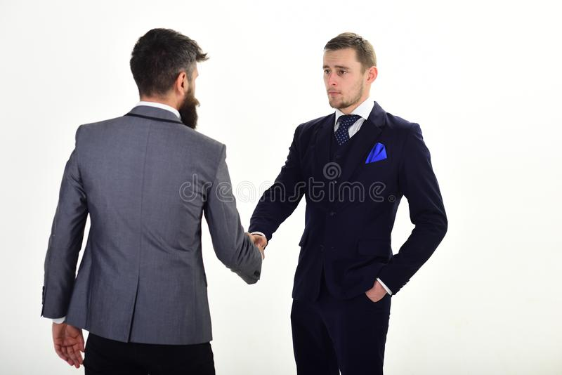 Handshake concept. Businessmen, business partners meeting, white background. Business partners on serious faces royalty free stock photography