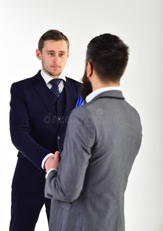 Handshake concept. Businessmen shaking hands, successful deal or acquaintance. Businessmen, business partners meeting stock photos