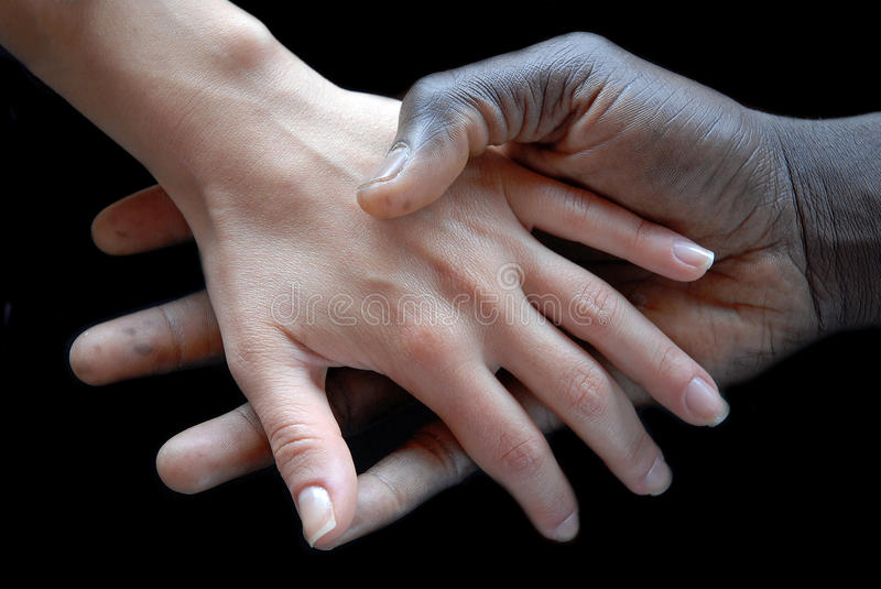 Handshake. Concept of no apartheid. Hands black and white royalty free stock image