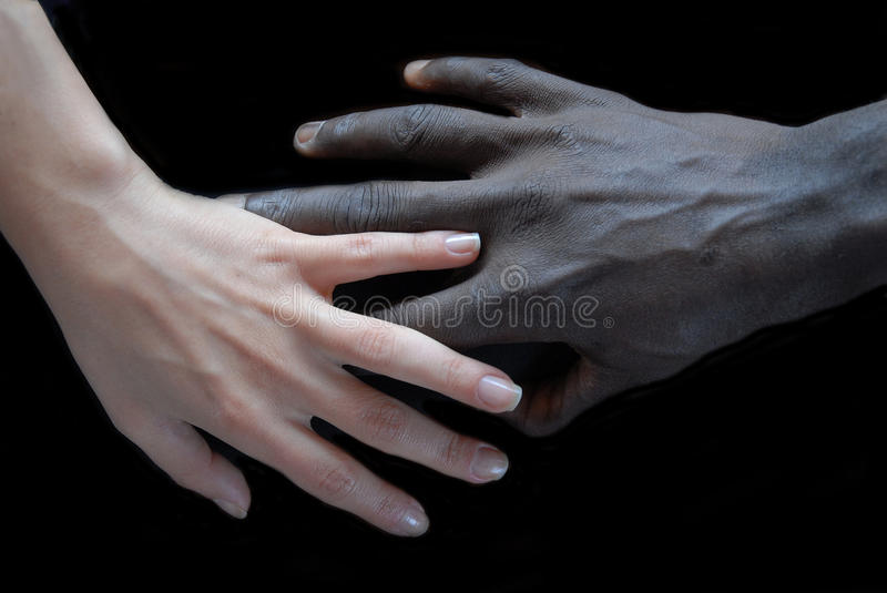 Handshake. Concept of no apartheid. Hands black and white royalty free stock photo