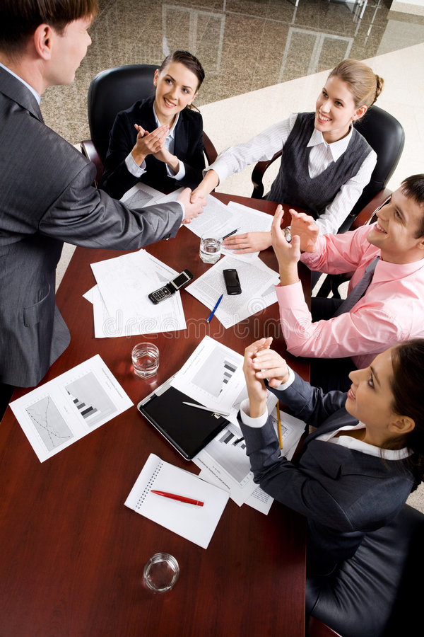 Handshake at conference royalty free stock photography