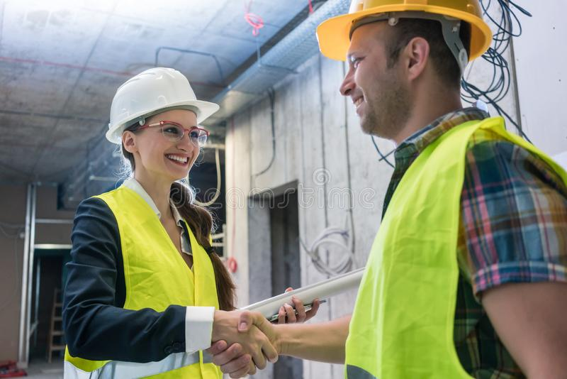 Handshake on the construction site royalty free stock photography