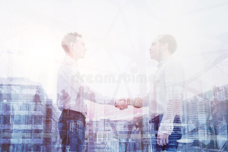 Handshake double exposure, business people cooperation concept royalty free stock photos