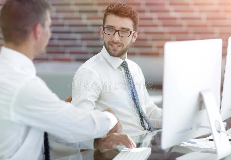 Handshake of the employees at the Desk royalty free stock photography