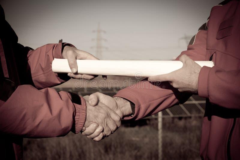 Handshake between Engineers stock photo