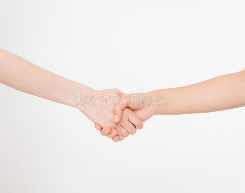 Handshake femminili isolati su fondo bianco Copi lo spazio fotografie stock