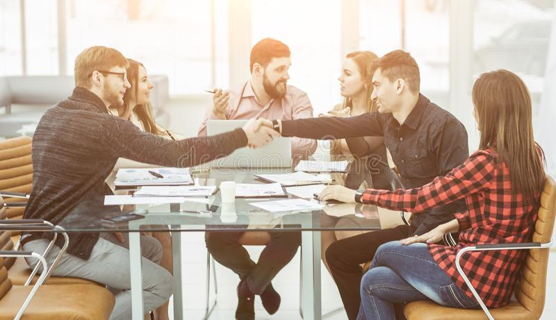 Handshake financial partners and business team in the workplace royalty free stock image
