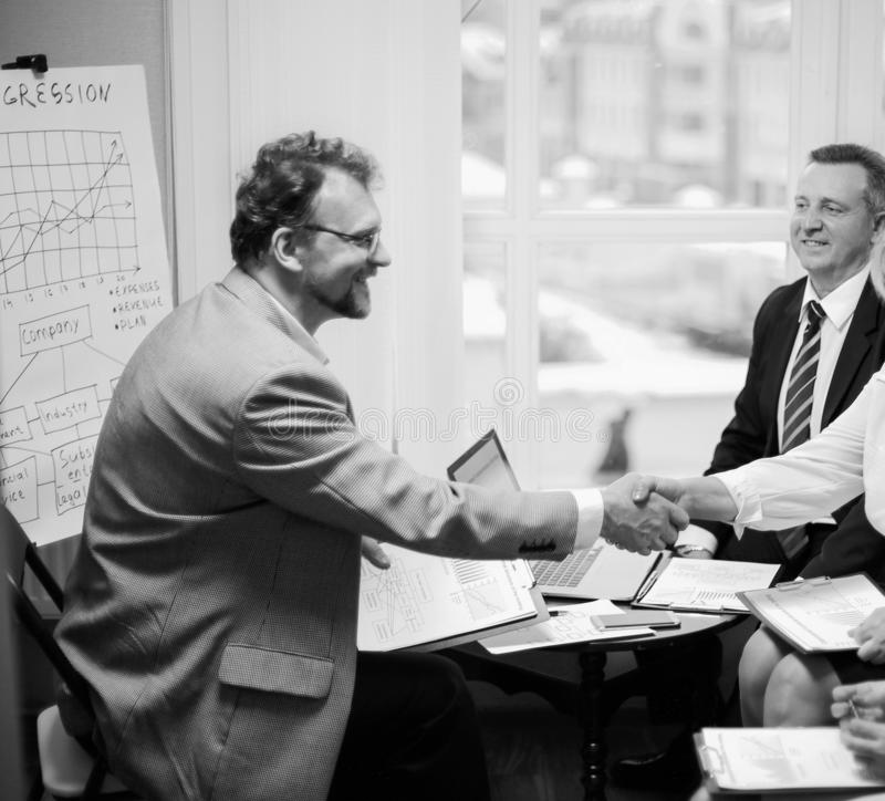 Handshake financial partners prior to discussion of the transaction. black and white photo. Handshake financial partners prior to discussion of the transaction stock photos