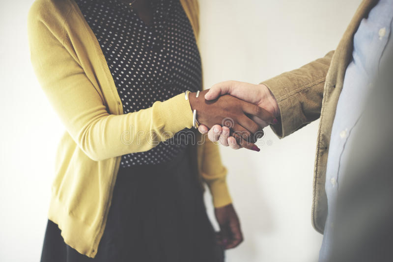 Handshake Gesturing People Connection Deal Concept.  royalty free stock photography