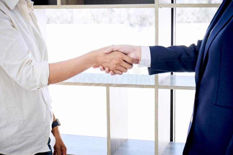 Handshake after good cooperation, Real estate broker residential. Agent shaking hands with customer after good deal agreement house rent listing contract royalty free stock photo