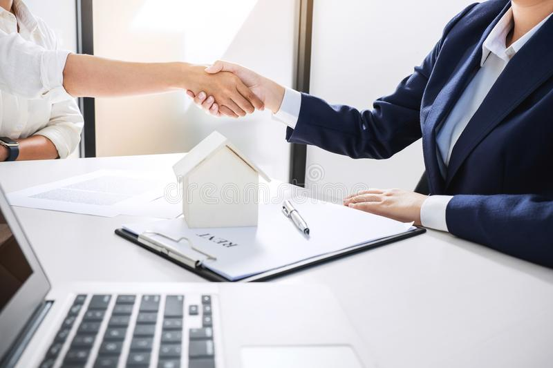 Handshake after good cooperation, Real estate broker residential. Agent shaking hands with customer after good deal agreement house rent listing contract stock images