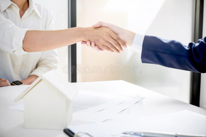 Handshake after good cooperation, Real estate broker residential. Agent shaking hands with customer after good deal agreement house rent listing contract royalty free stock images
