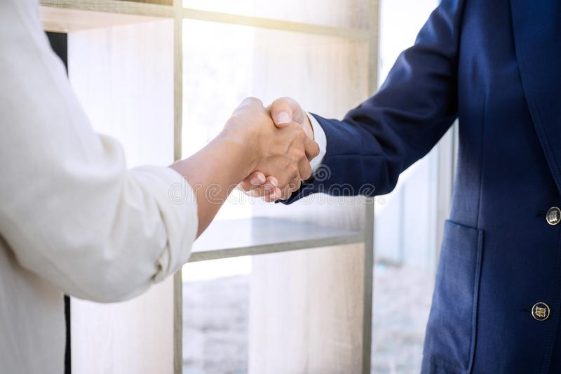 Handshake after good cooperation, Real estate broker residential. Agent shaking hands with customer after good deal agreement house rent listing contract stock photography