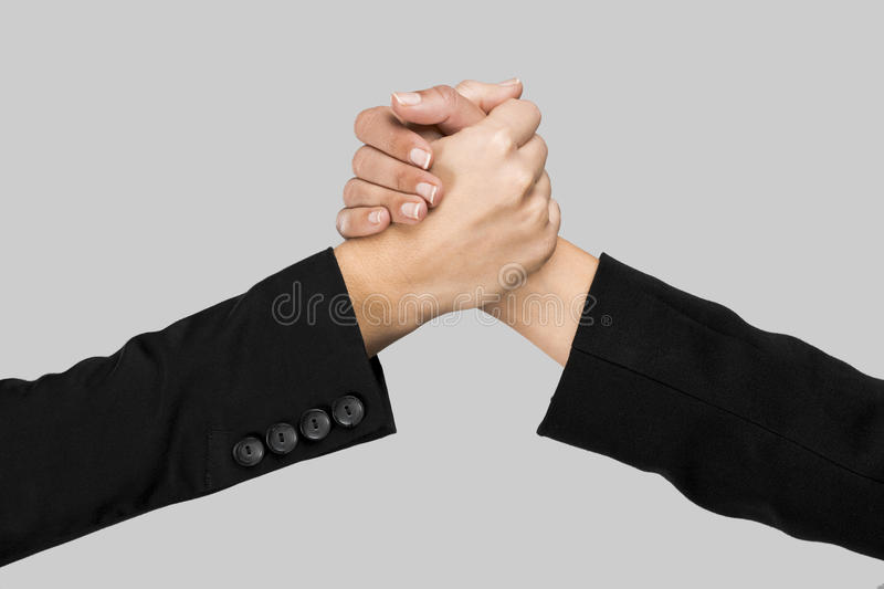 Handshake. Greeting hands over a gray background royalty free stock photo