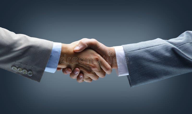 Handshake - Hand holding on. Black background