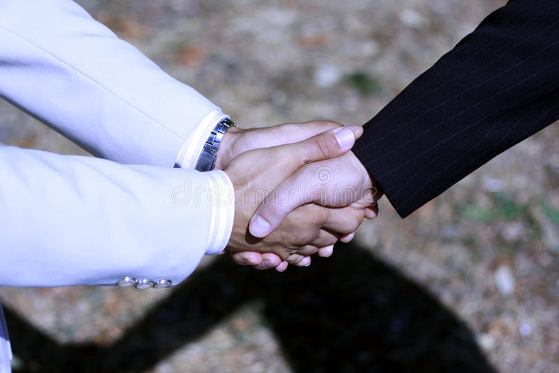Handshake - Hand holding royalty free stock photos