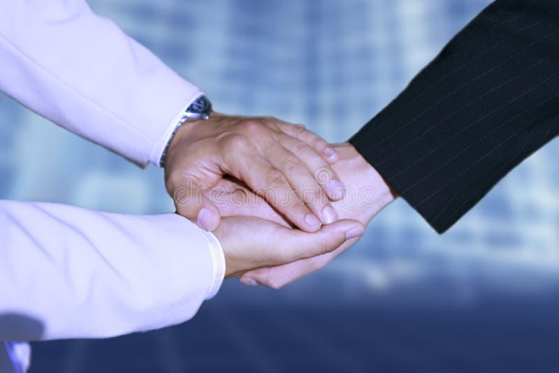 Handshake - Hand holding royalty free stock image
