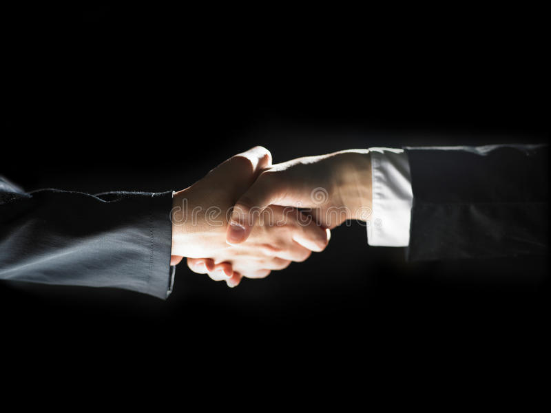 Download Handshake Handshaking On Light And Dark Stock Image - Image: 14860307