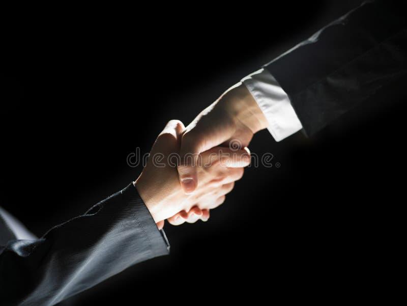 Download Handshake Handshaking On Light And Dark Stock Photo - Image: 14860340