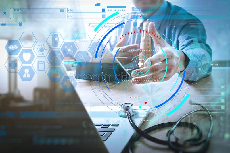 Handshake helping for business Medical technology concept. Doctor hand working with modern digital tablet dock screen computer wi. Health care and medical stock photos