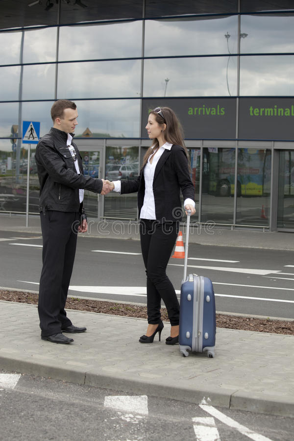 Free Handshake In Front Of Terminal Stock Photos - 33666583