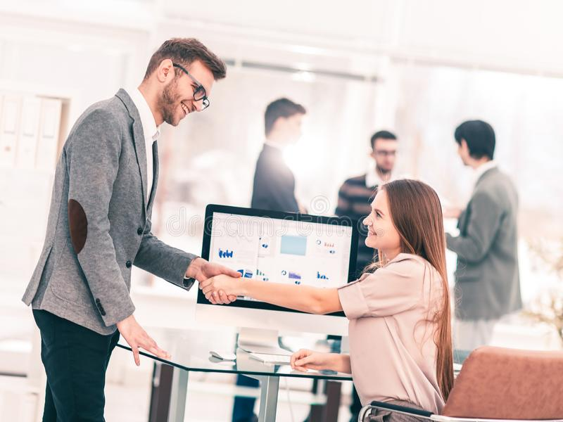 handshake between lawyer and client after reviewing the investment plan for development of the company. royalty free stock photo