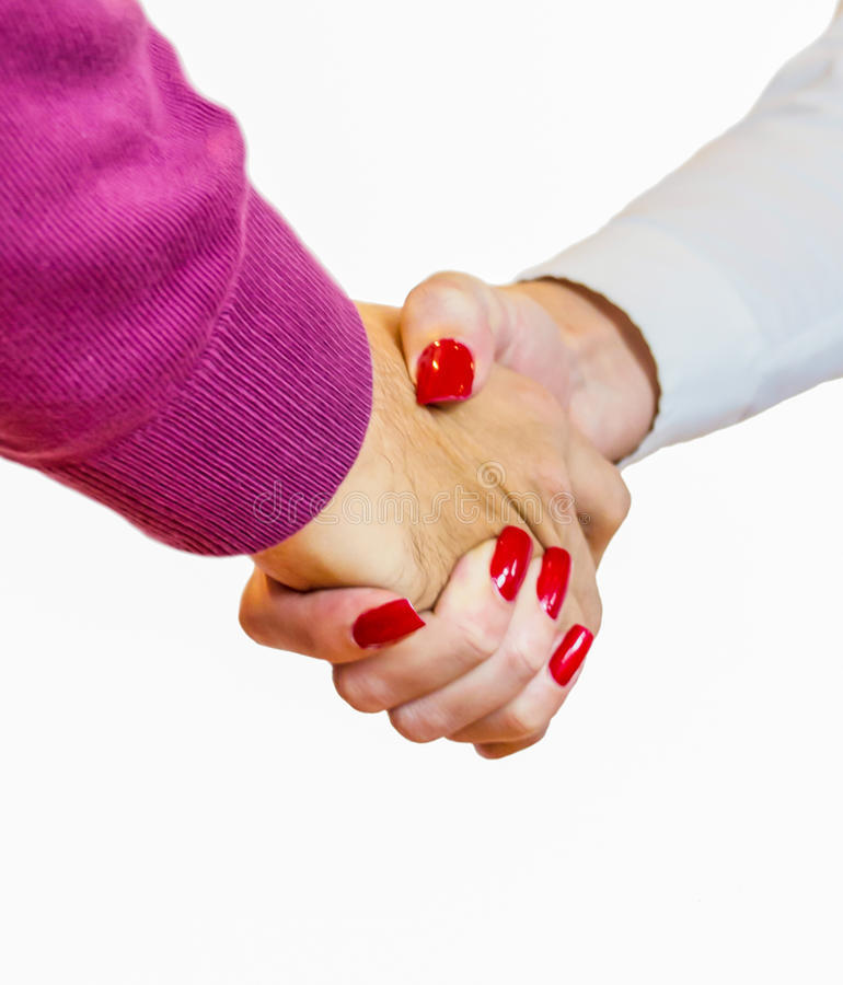 Handshake. Man and woman handshake closeup on white background royalty free stock image
