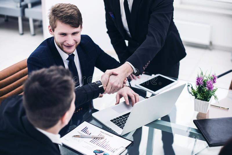 handshake Manager and the client after discussion of the financial contract in the workplace stock image