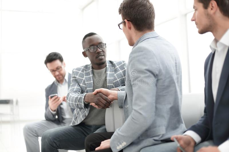 Handshake Manager and client in the office. royalty free stock photo